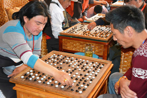 Players are playing Tibetan chess